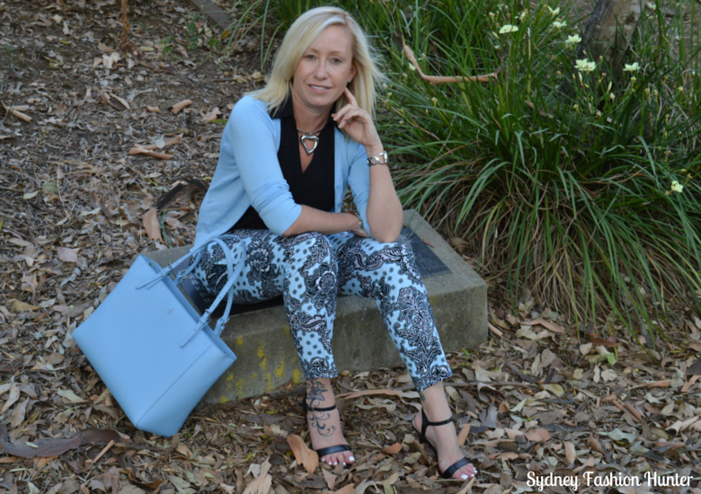 Light Blue Printed Panys, Black Sleeveless Potofino, Light Blue Cardigan, Black Sandals, Light Blue Tote Bag