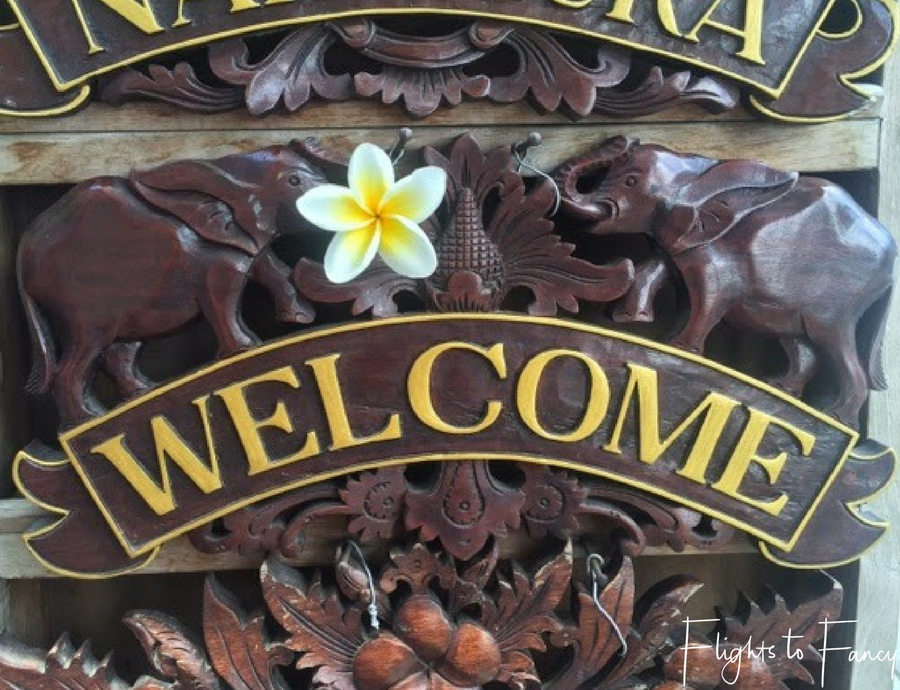 Flights To Fancy Wooden signs at the markets in Bali