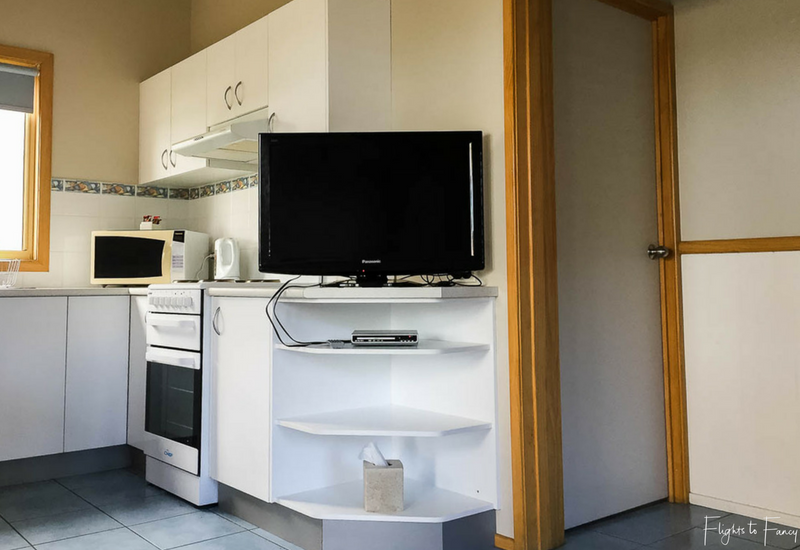 Kitchen in waterfront cabin at Great Lakes Caravan Park Forster
