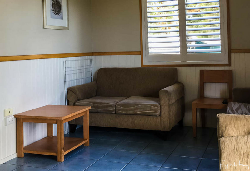 Lounge room in waterfront cabin at Great Lakes Caravan Park Forster