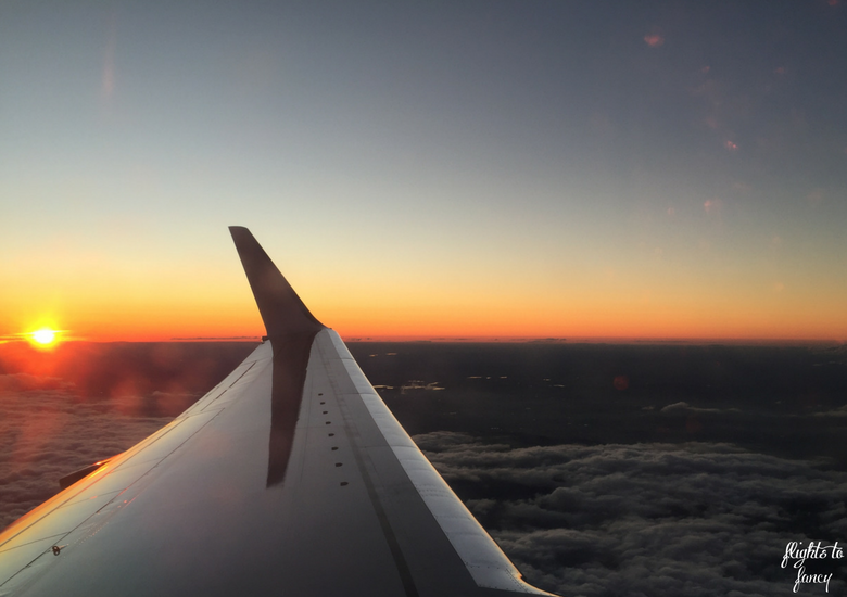 Flights To Fancy: How To Get Cut Price Airline Perks With Optiontown - Plane Window Sunset