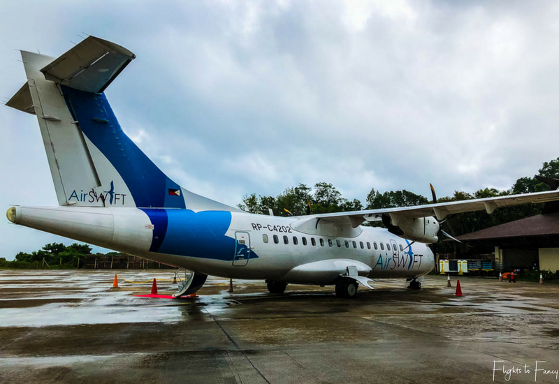 AirSWIFT Airlines flight T6337 on the ground at El Nido Airport