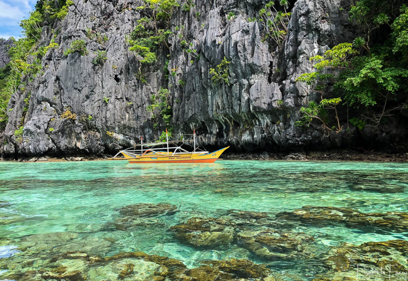El Nido Tour A - Small yellow boat at the Small Lagoon El Nido