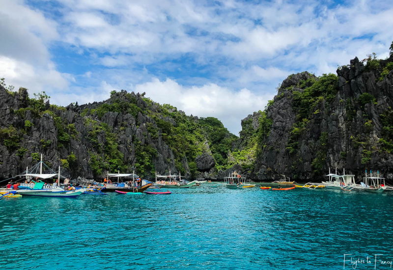 El Nido island hopping tour - Bangka boat traffic jam at the entrance to Small Lagoon El Nido