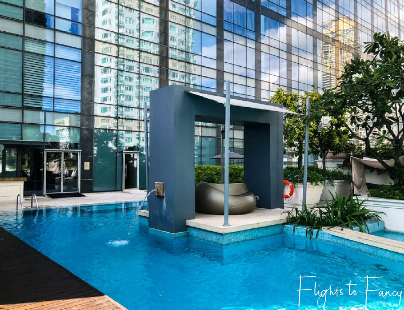 Flights To Fancy @ Raffles Makati - Fabulous pools always feature in 5 star hotels in Manila