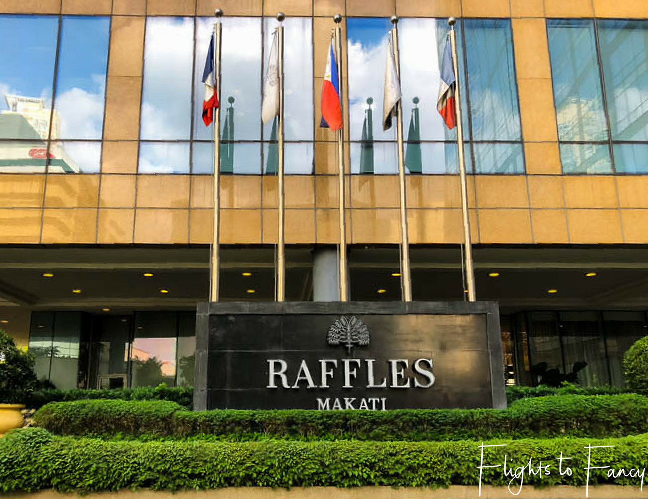 Flights To Fancy at Raffles Manila - There are always flags at the entrance of 5 star hotels in Makati