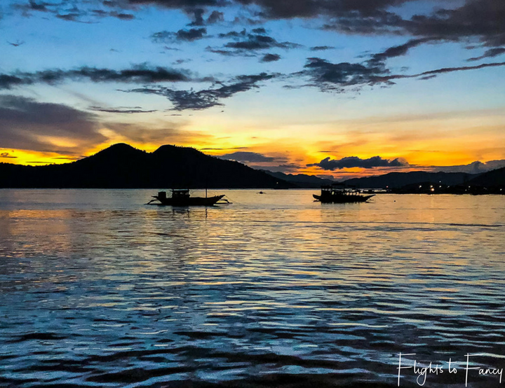 Where to stay in Coron: Sunset over the water at Sunlight Guest Hotel Coron Palawan