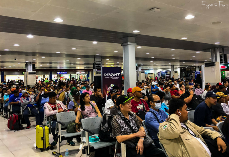 Packed waiting room at Manila NAIA terminal 4